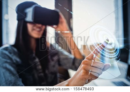 Digitally generated image of volume knob against woman using virtual reality headset