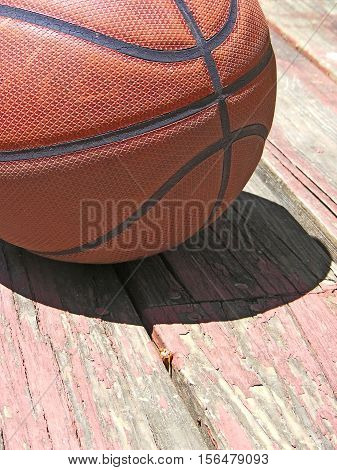photography with scene basketball ball on old wooden flooring