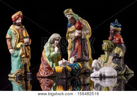 Christmas Manger scene with figurines including Jesus, Mary and magi. Focus on Mary!