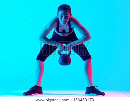 woman fitness Kettle Bell exercices isolated