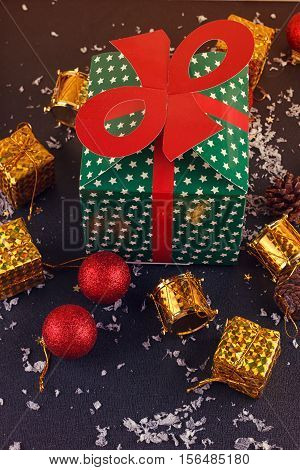 Christmas decorative gift box ball on black background