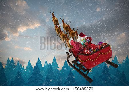 High angle view of Santa Claus riding on sled with gift box against fir tree forest