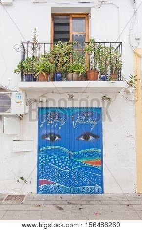 Beautifully Decorated Blue Door