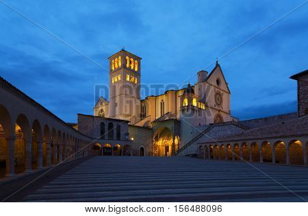 Famous Basilica of Saint Francis of Assisi with Lower Plazain night. Assisi Umbria Italy