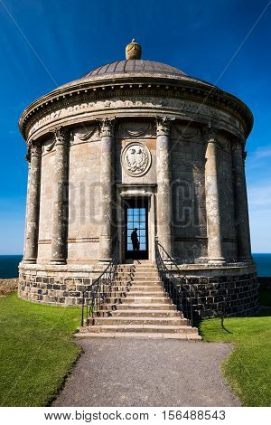 Mussenden Temple stands on the edge of  a cliff overlooking the Atlantic ocean. Built in 1785 it lies in the Downhill Demesne, once owned by Earl Bishop Frederick Augustus Hervey, the builder. Now owned by the National Trust. Featured in Game of Thrones a poster