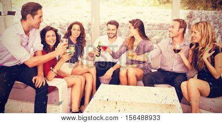 Friends talking and having drinks against flying colours
