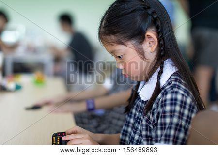 Child Playing Domino Game
