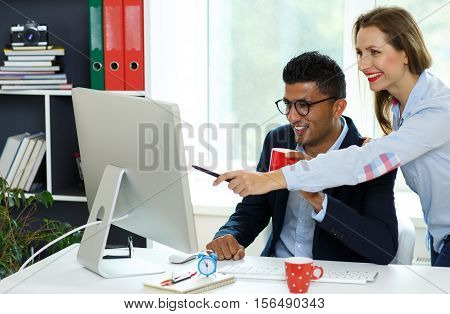 Beautiful young woman and man working from home office - modern business concept