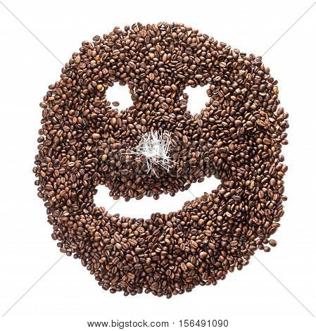 Funny smiley of coffee beans with a nose from tinsel isolated on white background.