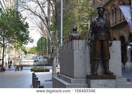 Sydney Australia - Oct 16 2016. Two bronze statues a soldier and a sailor guarding the cenotaph. It is one of the oldest World War I monuments at Martin Place Sydney Australia.
