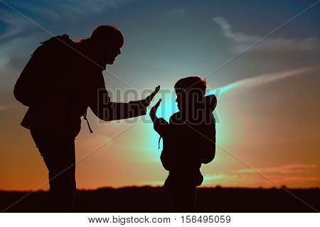 mother and little son travel at sunset sky, family tourism