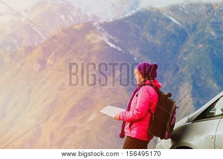young woman travel in scenic winter mountains