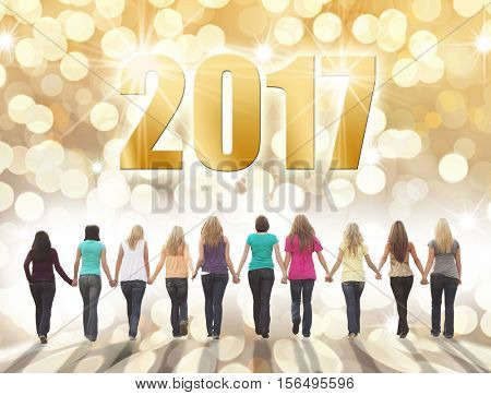 Ten young women walking hand in hand on a festive holiday background.