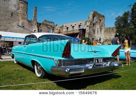 HAAPSALU, ESTONIA - JULY 18: American Beauty Car Show, showing blue 1957 Lincoln Premiere Coupe 2D HT, rear view on July 18, 2009 in Haapsalu, Estonia