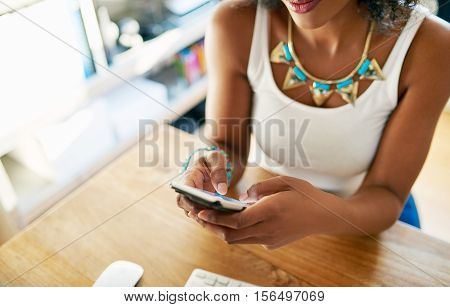 Woman With Cell Indoors.