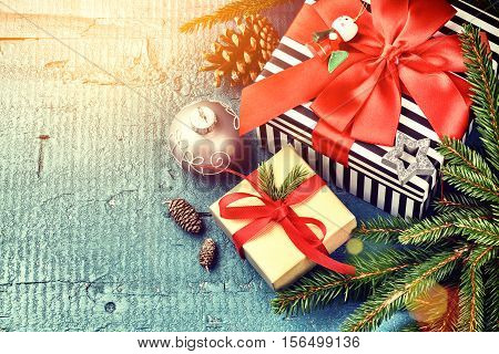 Christmas holiday setting with presents in boxes and festive decorations. Christmas background top view