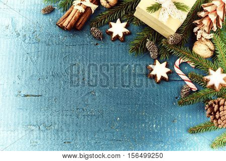 Christmas setting with seasonal spices fir branch and present in box. Christmas background with copy space