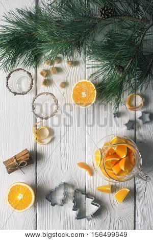 Set for orange grog preparation on the white wooden table