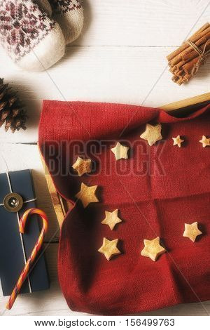 Christmas cookies on the red napkin in the tray with different accessorizes vertical