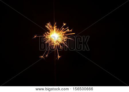 New year party sparkler on black background
