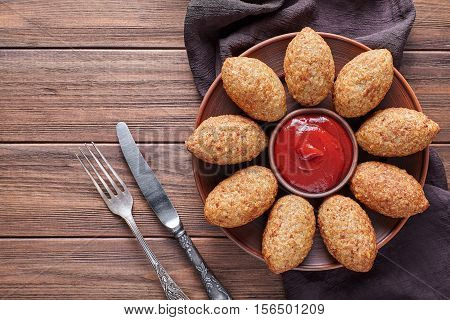 Kibbeh arabic beef, lamb, goat or camel meat stuffed bulgur kofta spicy meatball fried croquettes dinner food on rustic wooden table background