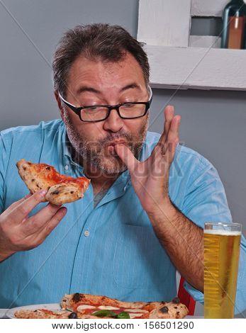 Fat man sucking finger eating pizza.