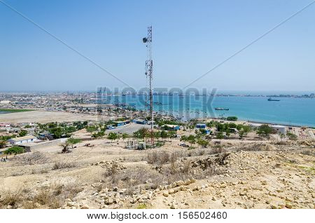 Radio antenna with the sea and town Lobito Angola in background. Desert scenery.