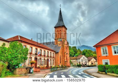 La Petite-Raon, the town hall and the Church of St. Sebastian and St. Quirinus - the Vosges Department, France