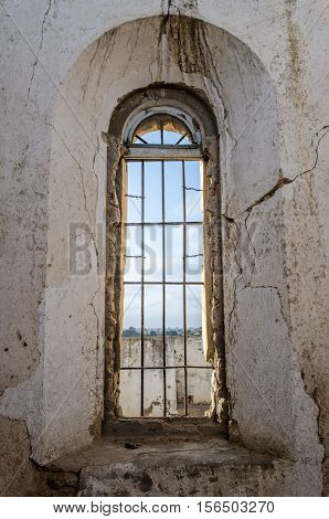 Tall window of Portuguese fort in Lobito Angola. The fort lies in ruins.