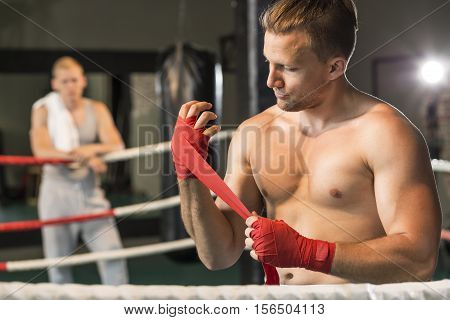 Boxer Wrapping Hands Before Training