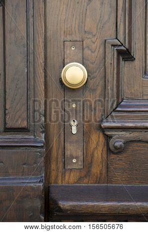 closeup of rustic wooden door with doorknob