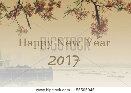 background of 2017 happy new year with red flamboyant and city building on fog in ho chi minh city vietnam