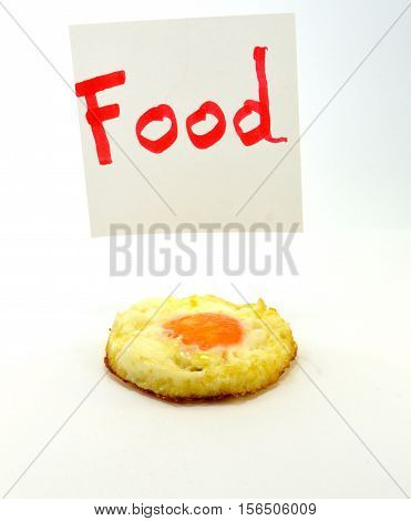 Mot Food written in red letters with an egg on the flat on a white background