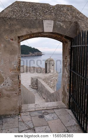 DUBROVNIK, CROATIA - NOVEMBER 30: Defense walls of the old town of Dubrovnik, a well-preserved medieval fortress and a popular tourist destination, Croatia, Croatia on November 30, 2015.