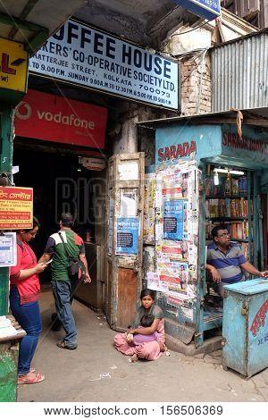 KOLKATA, INDIA - FEBRUARY 11: Students check out books at College Street Book Market in Kolkata, India on February 11, 2016.