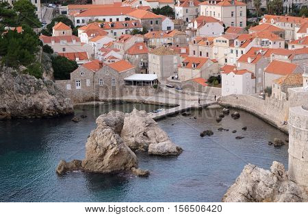 DUBROVNIK, CROATIA - NOVEMBER 30: Old port Kolorina, with the two forts Bokar and Lovrijenic standing as sentinals as defence of the walls of Dubrovnik, Croatia on November 30, 2015.