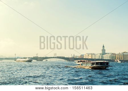 SAINT PETERSBURG RUSSIA-OCTOBER 3 2016.St Petersburg panorama-Neva river and Saint Petersburg landmarks of University embankment and Vasilievsky island with touristic boats in Saint Petersburg Russia