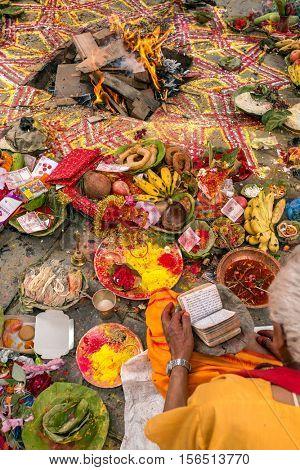 Kathmandu, Nepal - May 21, 2016: Brahmin make hindu puja ceremony in Kathmandu, Nepal