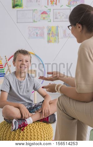Psychotherapist Talking With A Small Boy