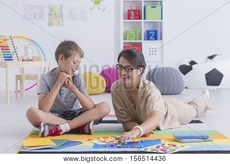 Babysitter Playing With A School-boy