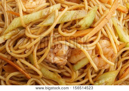 Chinese cuisine.Chinese food. Spaghetti with shrimps. Closeup.