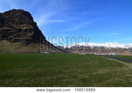 Lush landscape surrounding Stratovolcano which erupted in Iceland.