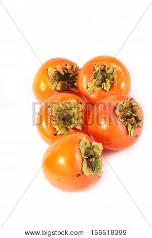 pile of ripe fresh tropical fruit persimmon prepared for eating