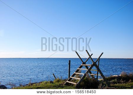 Wooden stile by a footpath along the coast