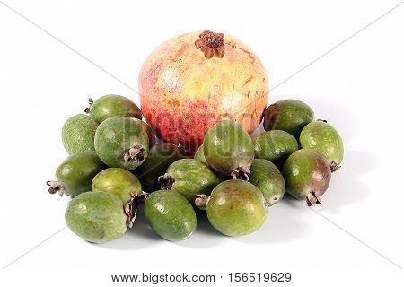 Fresh ripe pomegranate and pineapple guava fruit tropics