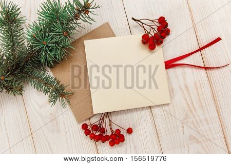 Christmas mokup.Tree branch frame empty cards with rowanberry .White wooden table.