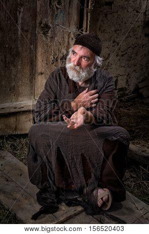 Biblical scene enpicting a beggar in the streets of Jerusalem