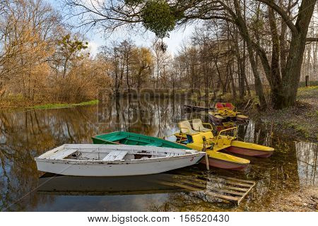 boats on moorage in autumn park