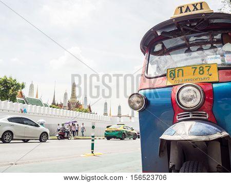 Bangkok Thailand - July 20 2016: Tuk Tuk taxi infront of the temple palace.