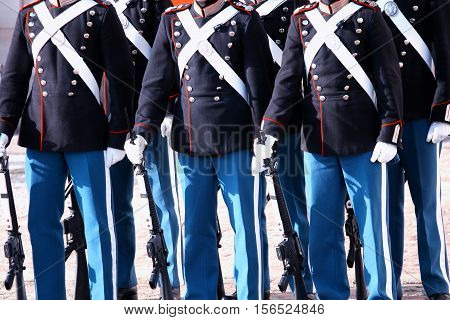 The Royal Guard with army guns in Copenhagen Denmark marching